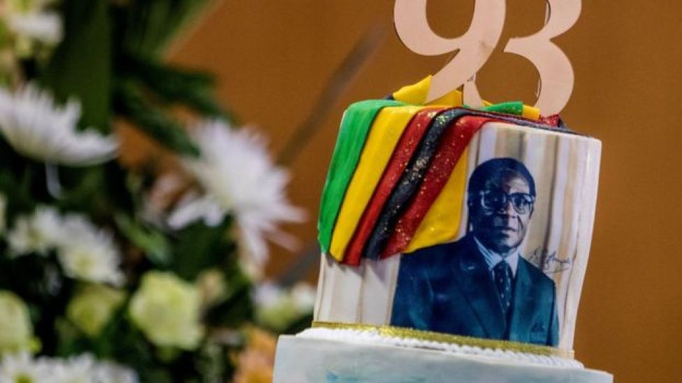 A picture taken on February 21, 2017 shows a cake bearing a portrait of Zimbabwe's President Robert Mugabe during a private ceremony to celebrate Mugabe's 93rd birthday in Harare. Mugabe, the world's oldest national ruler, turned 93, using a long and occasionally rambling interview to vow to remain in power despite growing signs of frailty.