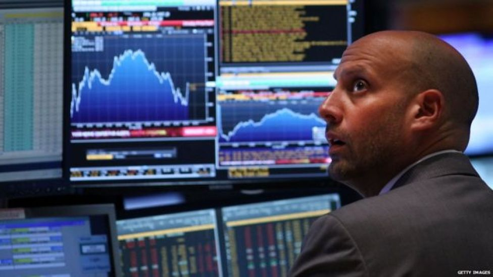A trader works on the floor of the New York Stock Exchange (NYSE) on 24 August 2015 in New York City.