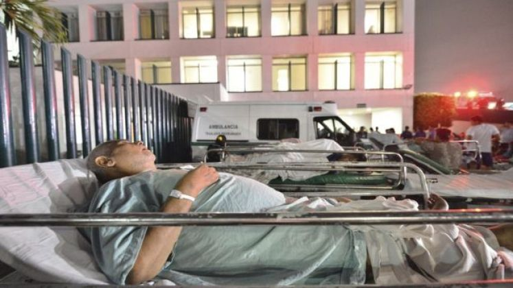 Patients at a hospital in Villahermosa, Mexico, remain in the open after a strong earthquake on 8 September 2017