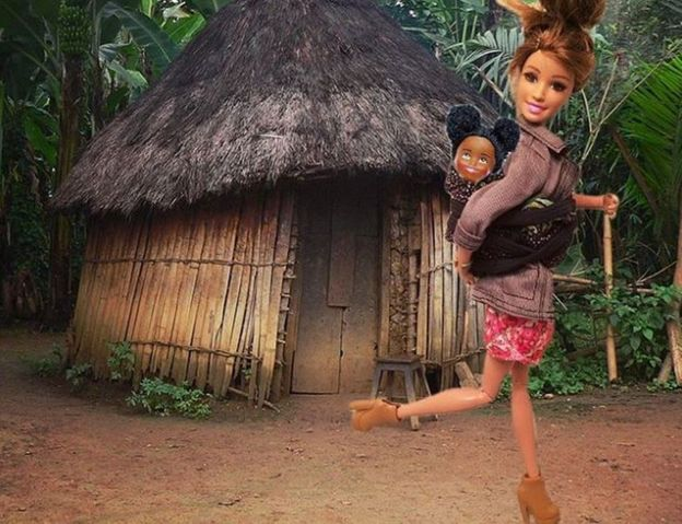 Barbie with a baby on her back