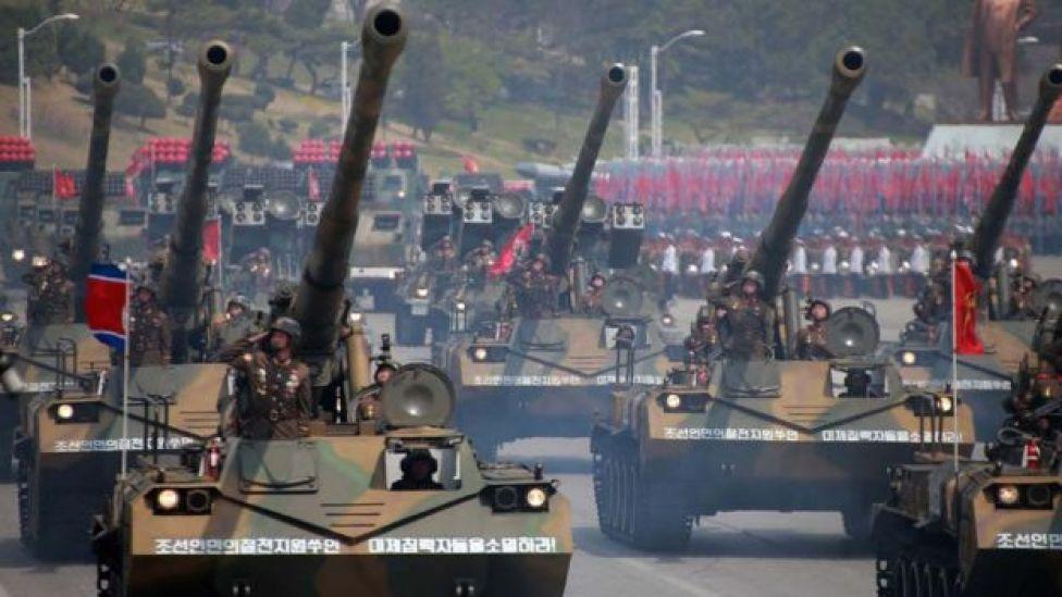 An April 2017 parade features dozens of tanks and artillery
