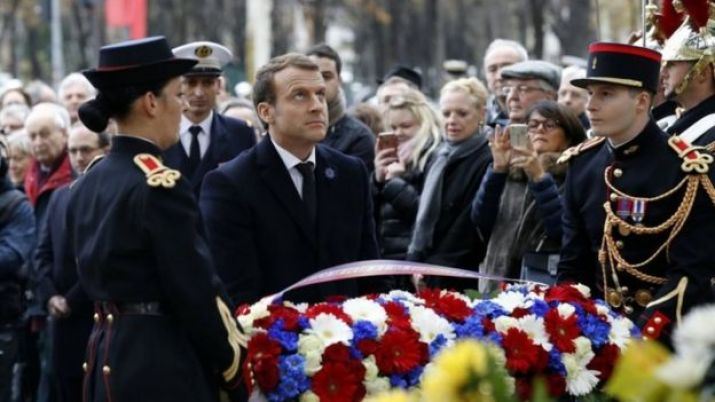 French President Emmanuel Macron lays a wreath in front of the statue of Georges Clemenceau in Paris