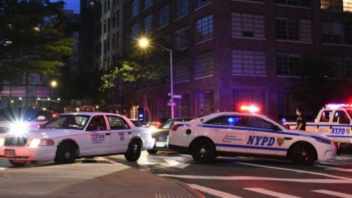 Police cars block a street during a protest in New York sparked by the death of George Floyd, 2 June 2020