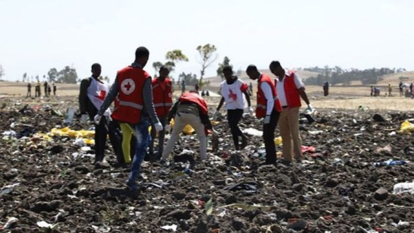 Red cross team work amid debris at the crash site of Ethiopia Airlines