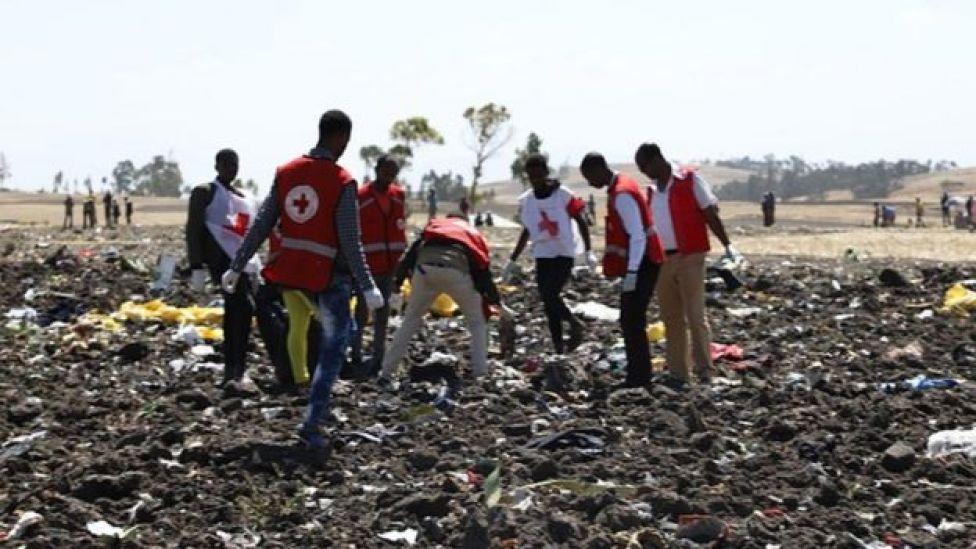Red cross team work amid debris at the crash site of Ethiopia Airlines
