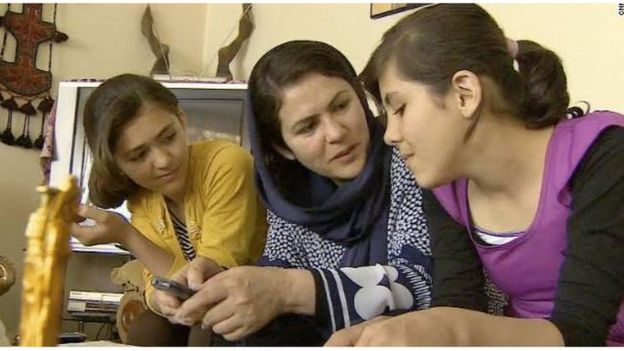 Fawzia Koofi flanked by her daughters