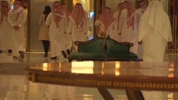 Saudimen in traditional dress are escorted through the Ritz Carlton in Riyadh.
