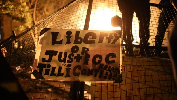 """A banner at a protest in Minneapolis says """"Liberty or justice till 'I can't breathe.' (28 May 2020)"""
