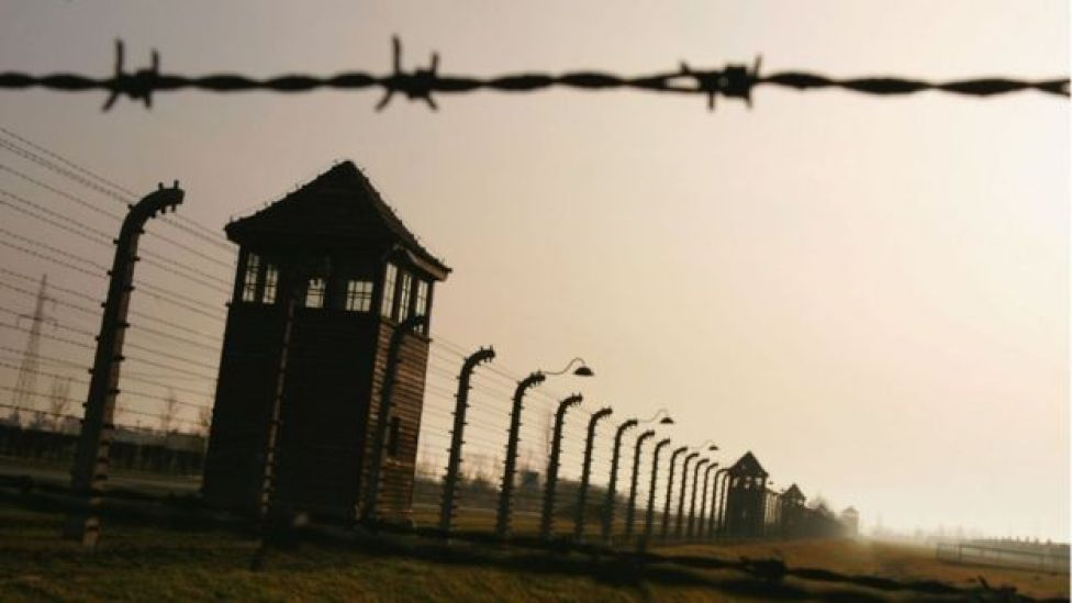 Image of Auschwitz watch tower, barbed wire and fencing