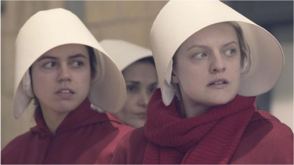 Nina Kiri and Elisabeth Moss in The Handmaid's Tale