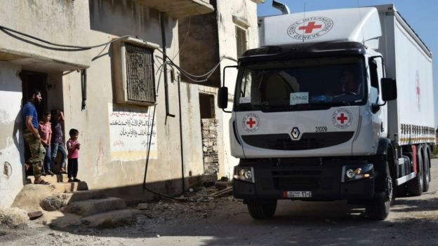 Aid delivery arrives in rebel-held town of Talbisseh on northern outskirts of Homs on September 19, 2016