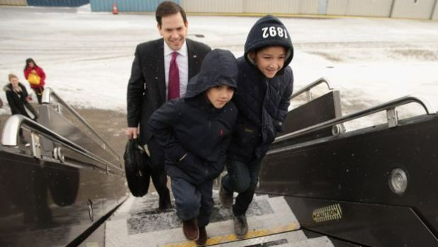 Marco Rubio boards a plane to South Carolina with sons