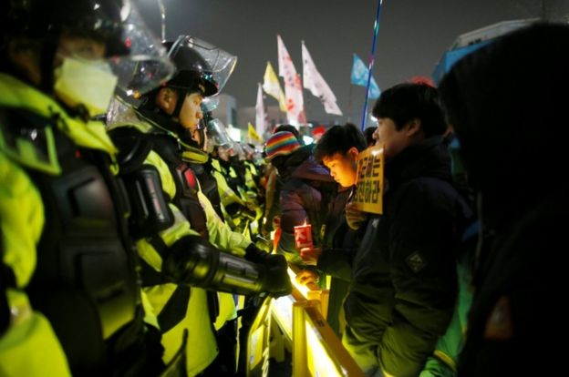 People attend a protest calling for Park Geun-hye to step down on a road leading to the Presidential Blue House in Central Seoul, South Korea, on 26 November, 2016