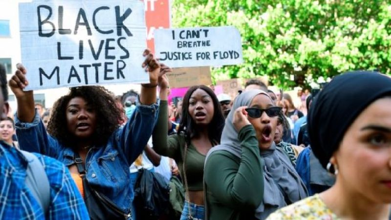 People attend a Black Lives Matter march, in solidarity with protests raging across the United States over the death of George Floyd, in Aarhus, Denmark June 3, 2020