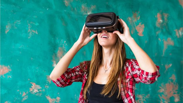 A woman with a virtual reality mask