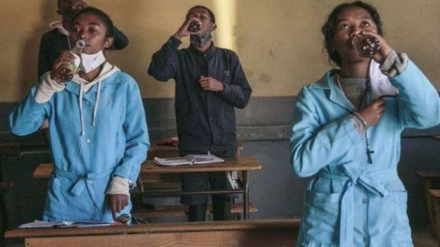 Students at Antananarivo school drinking Covid-Organics
