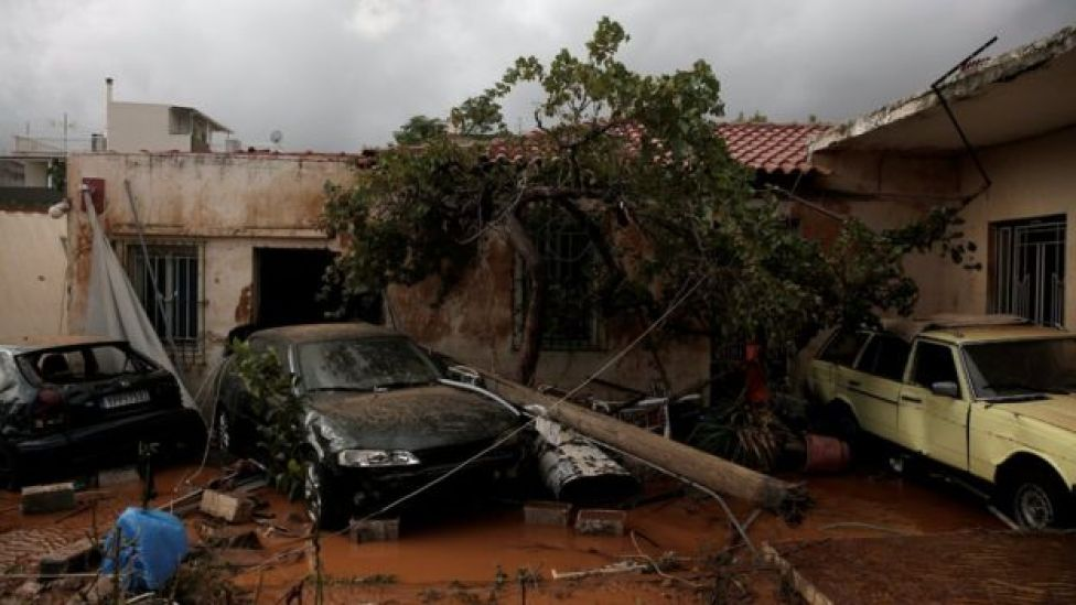 Destroyed cars are seen inside a yard following a heavy rainfall in the town of Mandra