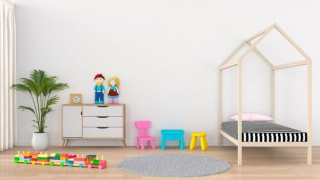 A modern children's bedroom, with a bed, a chest of drawers, a plant and some toys