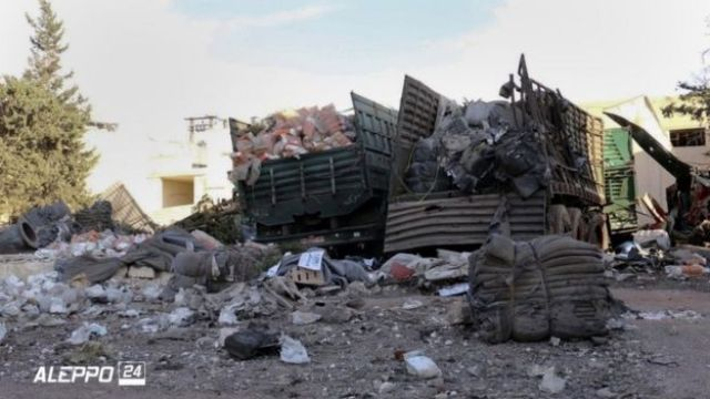 Aftermath of aid convoy attack, showing aid on ground and destroyed lorries