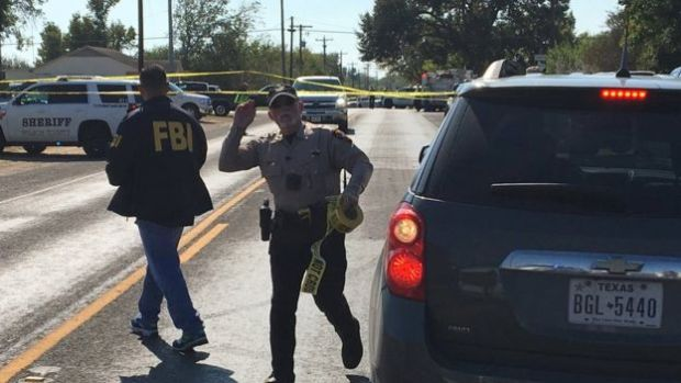 FBI officials arrive at the site of a mass shooting in Sutherland Springs, Texas