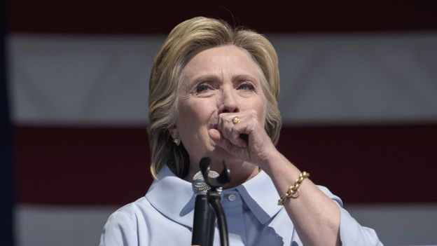 Hillary Clinton coughs during a campaign rally in Cleveland, Ohio, 5 September 2016