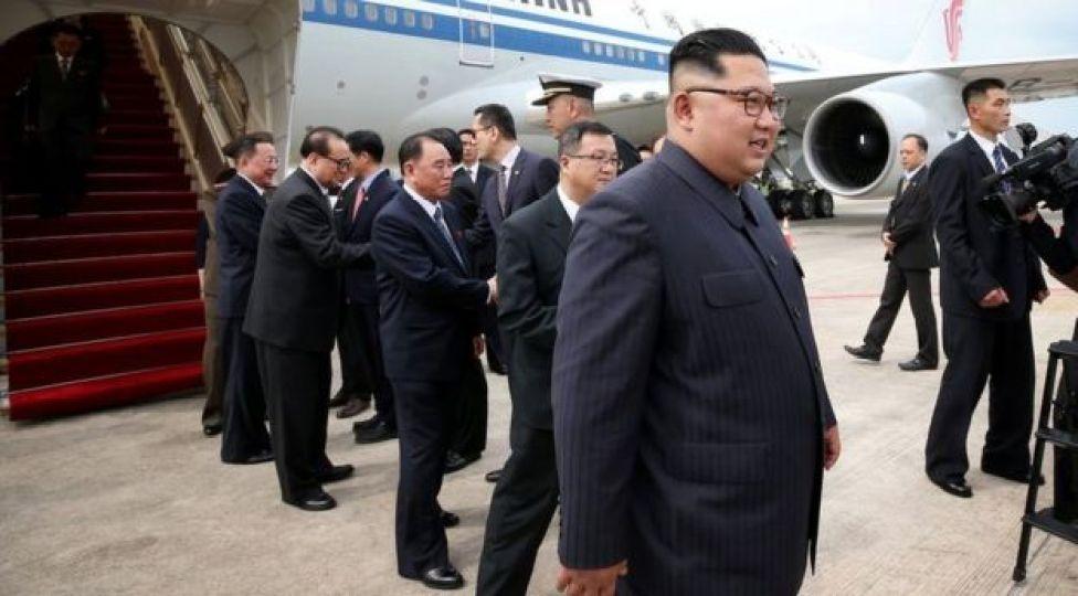 Kim Jong-un walking off his plane in Singapore