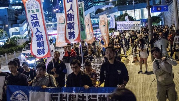 Protesters march in Hong Kong against a rumoured interpretation of the law by Beijing