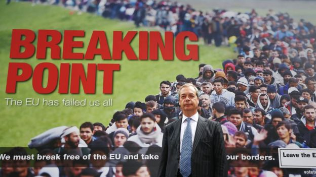 Nigel Farage with UKIP poster