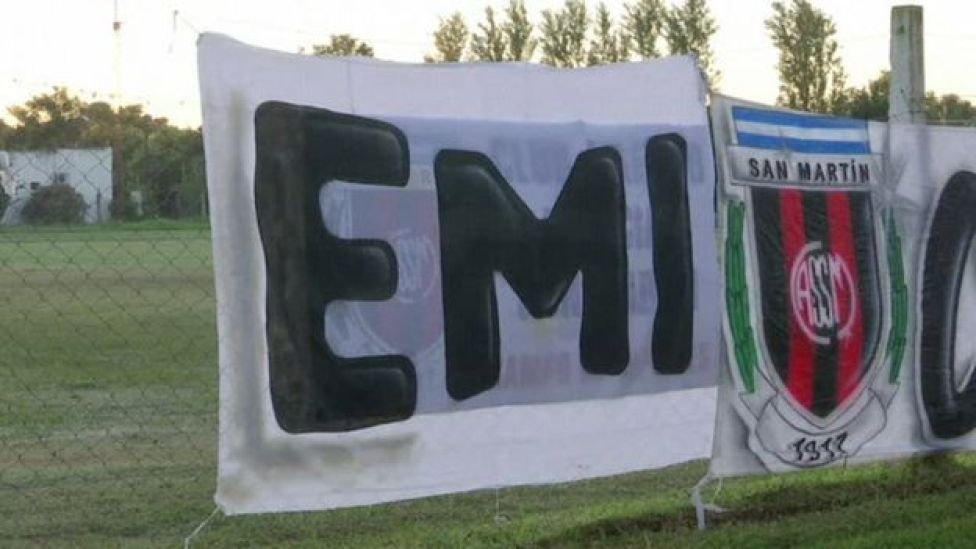 A sign reading Emi