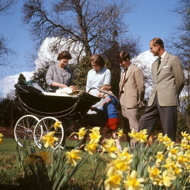 Queen Elizabeth II, baby Prince Edward, Princess Anne, Prince Andrew, Prince Charles and the Duke of Edinburgh, in the gardens of Frogmore House, Windsor, Berkshire, as they celebrate the Queen's 39th birthday. The same pram was used to ferry the Queen's great-granddaughter Princess Charlotte to her christening in July 2015.