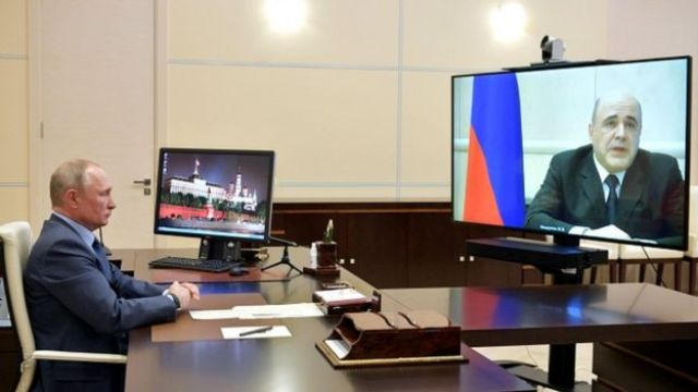 President Putin listens to Prime Minister Mikhail Mishustin during their meeting via a video link at the Novo-Ogaryovo state residence outside Moscow, Russia April 30, 2020