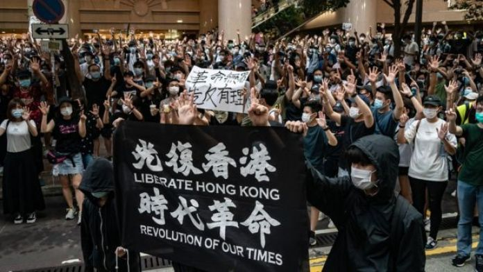 Demonstrators in Hong Kong take part in a protest against the new national security law