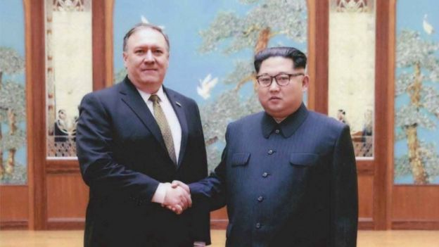 A U.S. government handout photo released by White House Press Secretary Sarah Huckabee Sanders shows U.S. Central Intelligence (CIA) Director Mike Pompeo meeting with North Korean leader Kim Jong Un in Pyongyang, North Korea in a photo that Sanders said was taken over Easter weekend 2018.