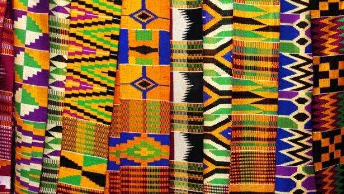 Kente cloth is display in eastern Ghana, May 13, 2004.