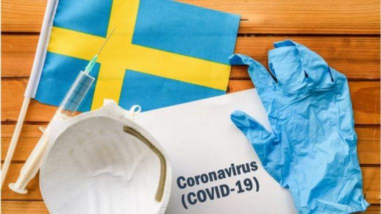 Máscara, injeção, luva e bandeira da Suécia