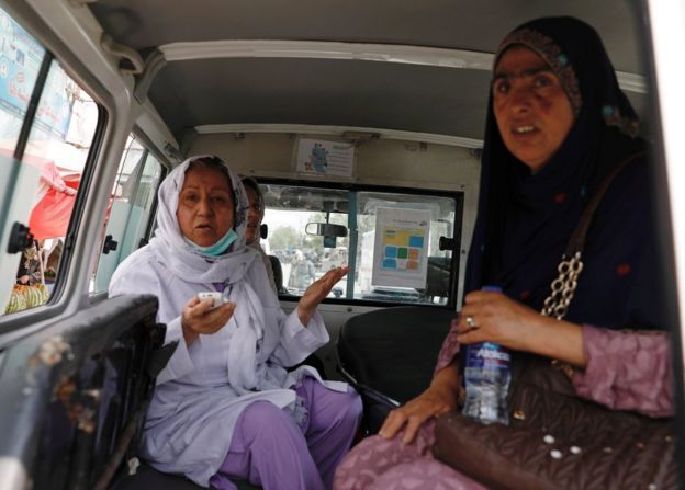 Two women waiting in an ambulance after being rescued from the hospital
