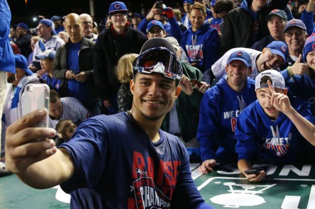 The Chicago Cubs celebrate in Chicago, 22 October