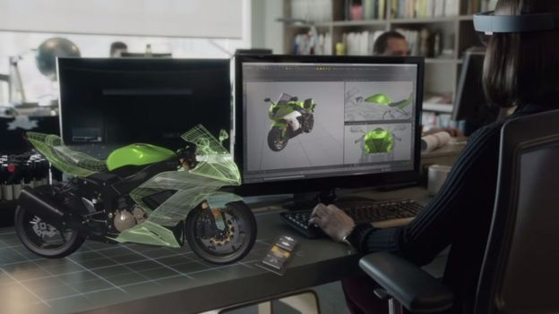 Screengrab from Microsoft HoloLens video showing hologram motorbike on desk