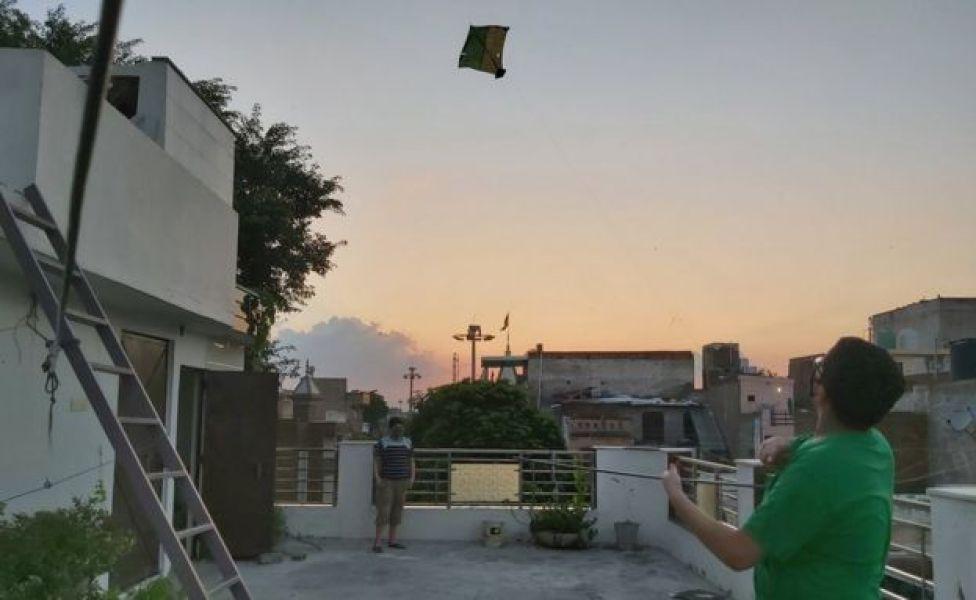 A child flying a kite in Delhi