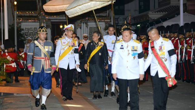 A royal handout photo shows Thai Crown Prince Maha Vajiralongkorn (2nd L) and Princess Maha Chakri Sirindhorn (C) arrive for the royal bathing ceremony for the late king 14 October