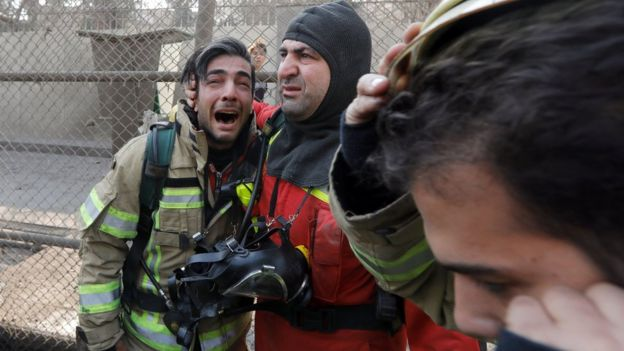 A firefighter reacts at the site of a collapsed high-rise building in Tehran, Iran (19 January 2017)