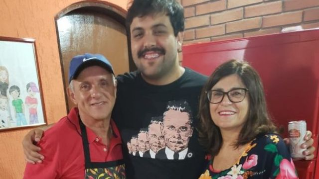 Vera Lucia (right) with her son and her husband Paulo