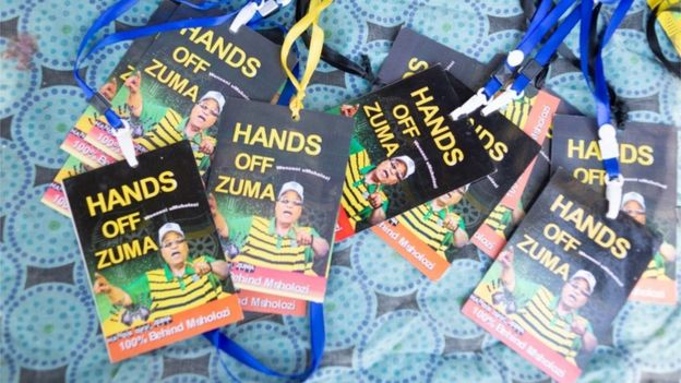 Accreditation badges for supporters of former South African President Jacob Zuma gather outside the Commission of Inquiry into Allegations of State Capture, Johannesburg, South Africa, 15 July 2019.