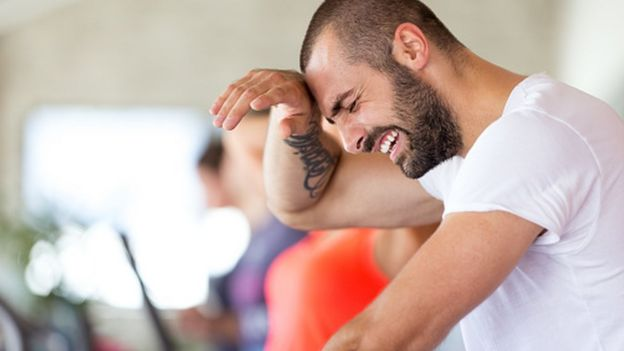 Man exercising vigorously in a gym