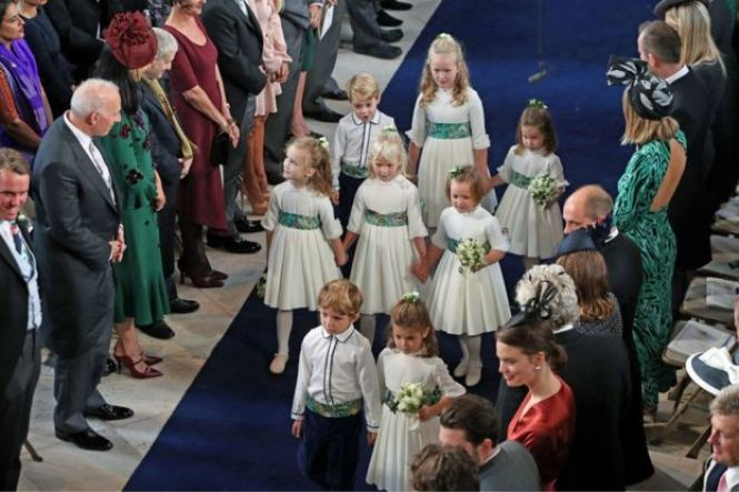 """The bridesmaids and page boys arrive for the wedding of Princess Eugenie to Jack Brooksbank at St George""""s Chapel in Windsor Castle, Windsor, Britain, October 12, 2018"""