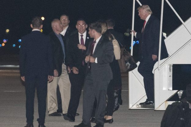 US President-elect Donald Trump (R) steps off his plane upon arrival at Palm Beach International Airport in West Palm Beach, Florida, 22 November