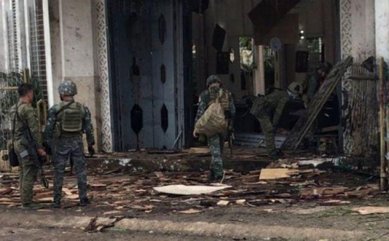 Soldiers gather evidence at the scene of two bomb attacks in Jolo. Photo: 27 January 2019