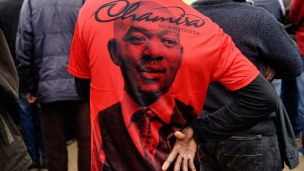 A supporter wears a t-shirt showing the face of Movement for Democratic Change Alliance leader Nelson Chamisa at an election rally on July 7, 2018 in the mining town of Zvishavane, Midlands province Zimbabwe