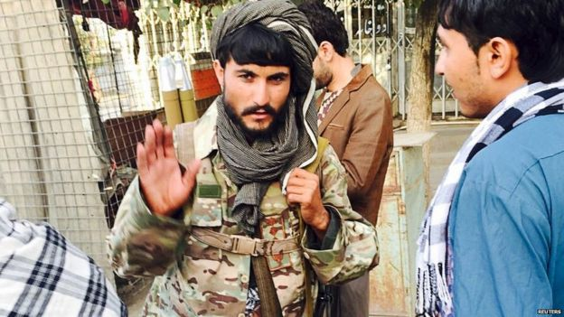 A Taliban fighter on the streets of Kunduz
