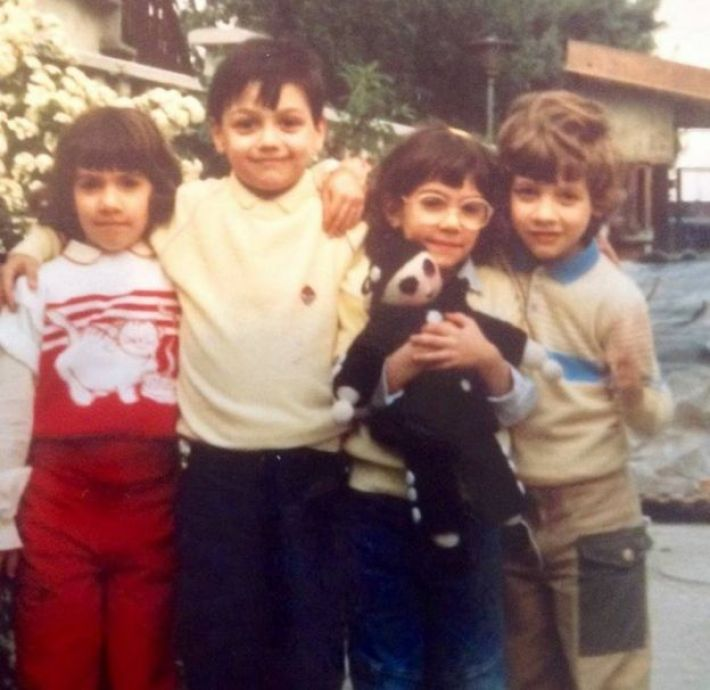Andrea Mongiardo (centre left) with his triplet cousins Marta, Valentina and Marco in Milan